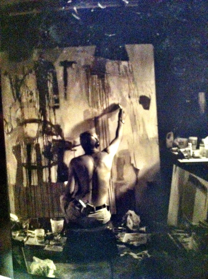 Omar McDonald painting in his studio